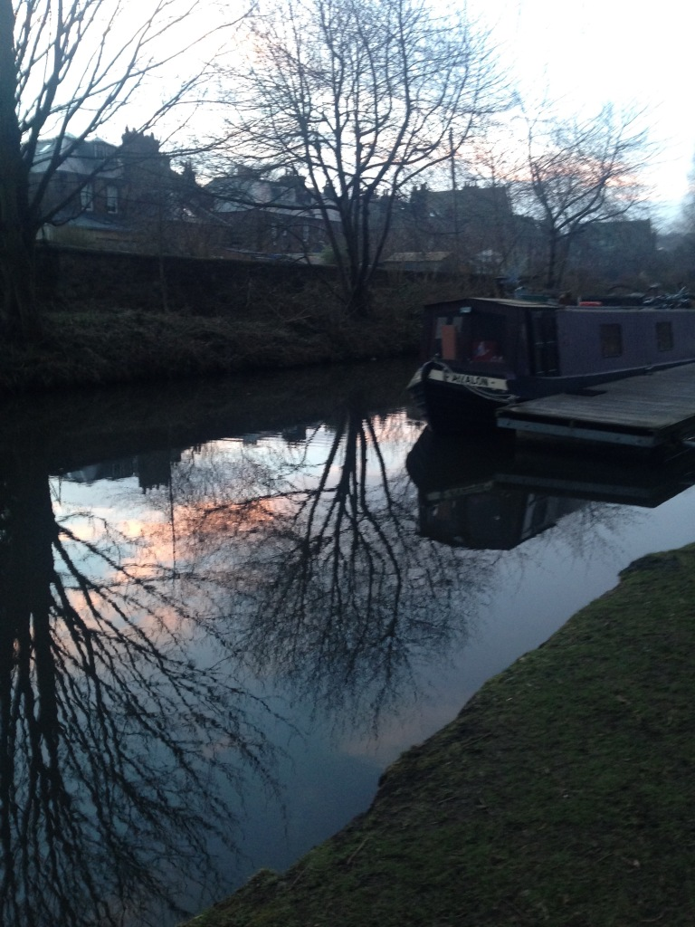 canal boat, reflective water