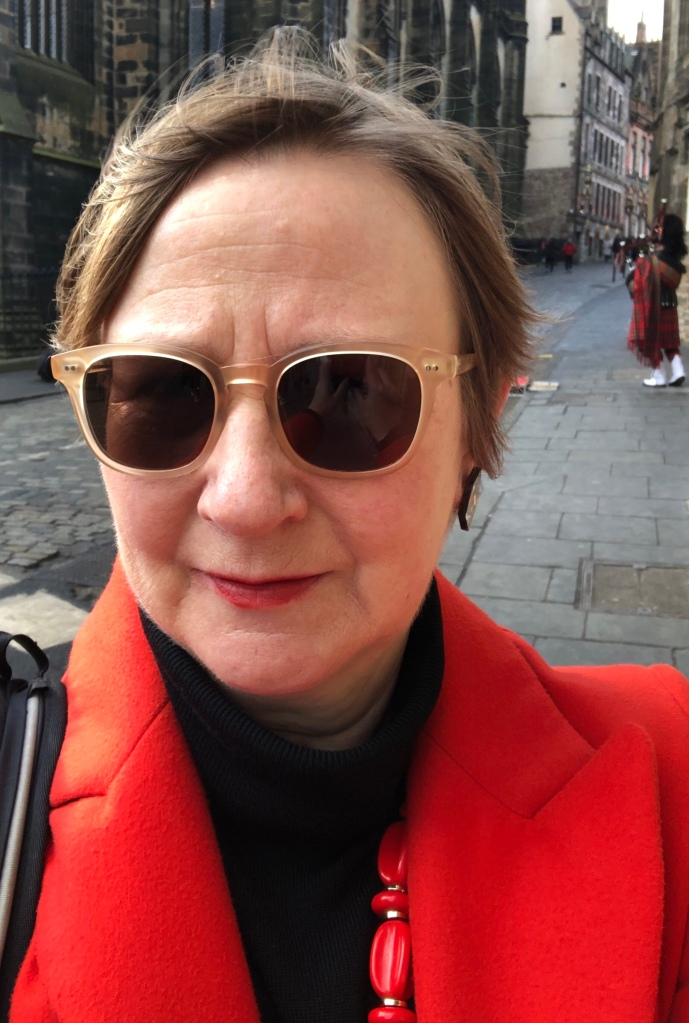 Blog author in a red coat